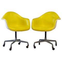 Pair of Herman Miller Upholstered Shell Swivel Chairs by Charles and Ray Eames