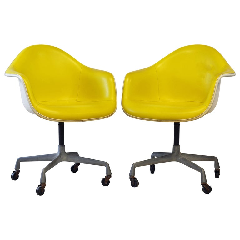 Pair of Herman Miller Upholstered Shell Swivel Chairs by Charles and Ray Eames For Sale