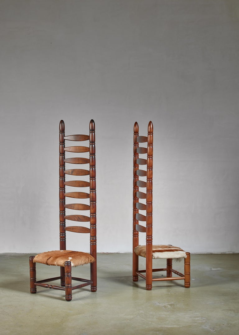 A pair of decorative Bohemian object chairs from the 1960s. This matching pair of high back ladder chairs is upholstered with goatskin.