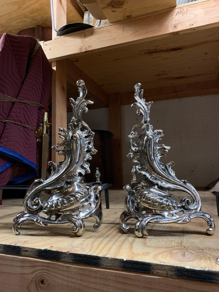 Set of andirons in the shape of flame, fully restored, can be set up to right or left of each other.