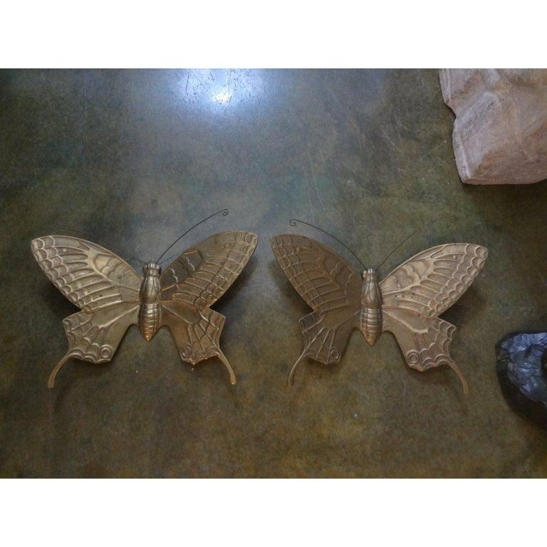 Great pair of midcentury brass butterfly wall sculptures. This matching pair of vintage Curtis Jere style brass butterflies would look great mounted on a wall, sitting on a table or in a bookcase. Would be fabulous converted into a pair of wall
