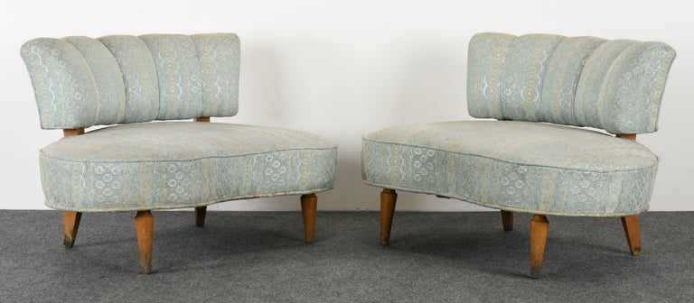 A wonderful pair of extra large scale upholstered chairs in the manner of Grosfeld House. The size of these are extra wide and can be considered settees. New upholstery and refinishing recommended. Structurally sound. Perfect chairs for