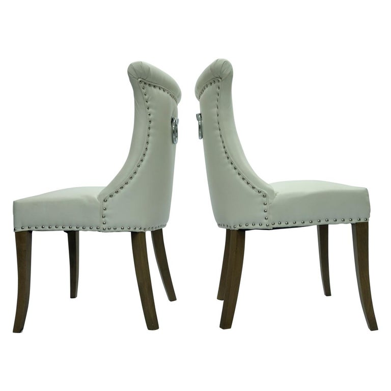 Faux Leather Pair of Hollywood Regency Dining Chairs with Rolled Back and Nail Head Trim For Sale