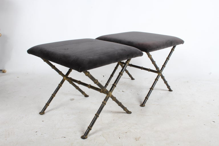 Pair of Hollywood Regency Chinese Chippendale painted iron faux bamboo X-base ottomans. Older re-upholstery shows stains should be updated. Inquire on price to upholstery COM. Well-made iron faux bamboo legs with black paint and dark yellow