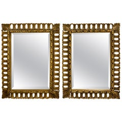 Pair of Hollywood Regency Gilt Ring Motif Mirrors