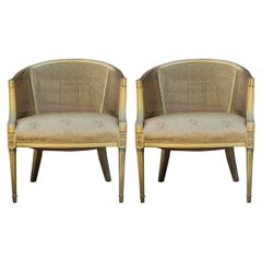 Pair of Hollywood Regency Gold Cane Barrel Back Lounge Chairs