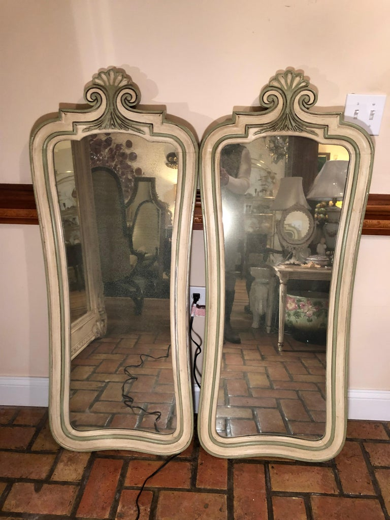 Pair of Hollywood Regency mirrors. Fabulous mercury like tint to these vintage mirrors. Great for above  master bathroom sinks. Please request a parcel quote from the seller or 1stdibs . Please provide your zip code.