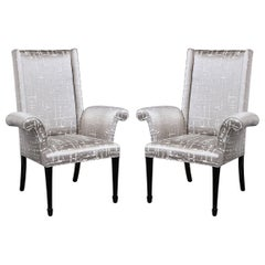 Pair of Hollywood Regency Scroll Form Ebonized Walnut & Textural Silk Armchairs