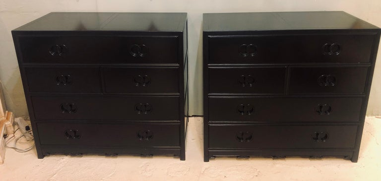 Pair of Hollywood Regency style Ebony Michael Taylor designed chests for baker. This stunning Steinway black lacquered chests, commodes or nightstands have been professionally done over and are simply spectacular. The large five drawer chests having