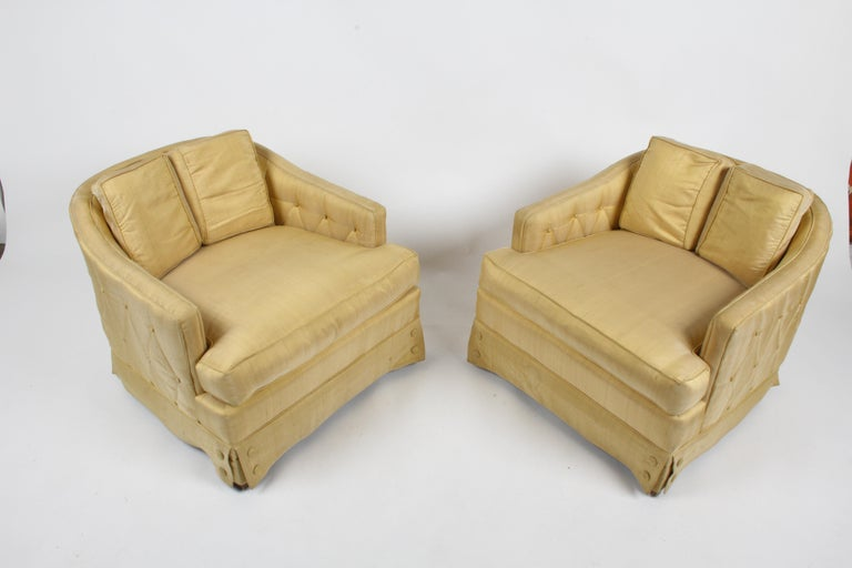 A pair of very sophisticated and elegant lounge chairs with silk diamond tufted outer panels and large buttons on skirts, with down seat cushions, by Tomlinson as part of their Parkway Terrace Collection c. 1962. Set includes original single ottoman