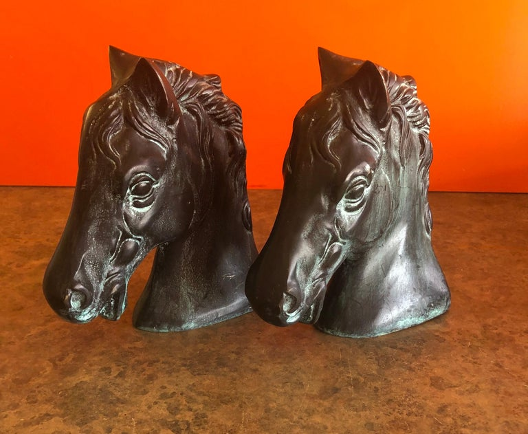 Classic pair of horse head bookends in bronze, circa 1970s. The pair are quite heavy and filled with sand; really nice patina! #1143.