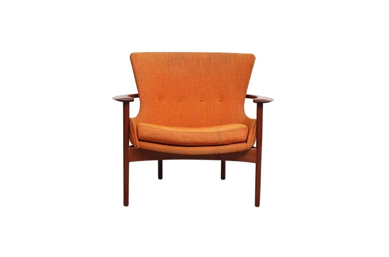 """Pair of rare """"Horseshoe"""" lounge chairs by Ib Kofod-Larsen for Selig. Sculptural teak frames and upholstered seat reminiscent of the more common """"Elizabeth"""" chair. Chairs retain their original paper labels and have Selig medallions. Chair model"""