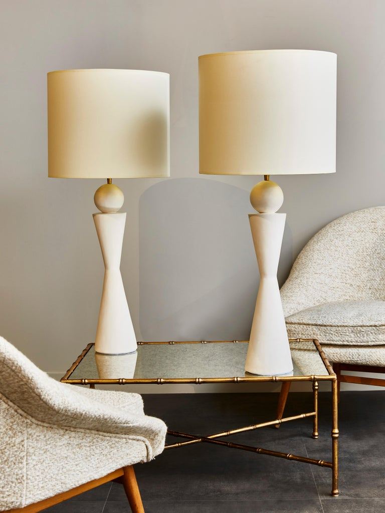 Pair of plaster table lamps in hourglass shape with brass settings.  Contemporary work made in France.