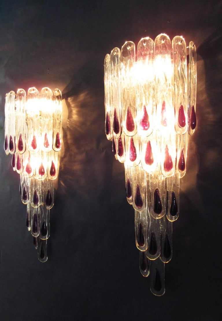 Big and fantastic pair of Murano glass sconces possibly by Mazzega made by 27 Murano transparent with purple spot for each applique in a chrome metal frame. Period: Late 20th century Dimensions: 33.45 inches height (85 cm), 13.80 inches width (35