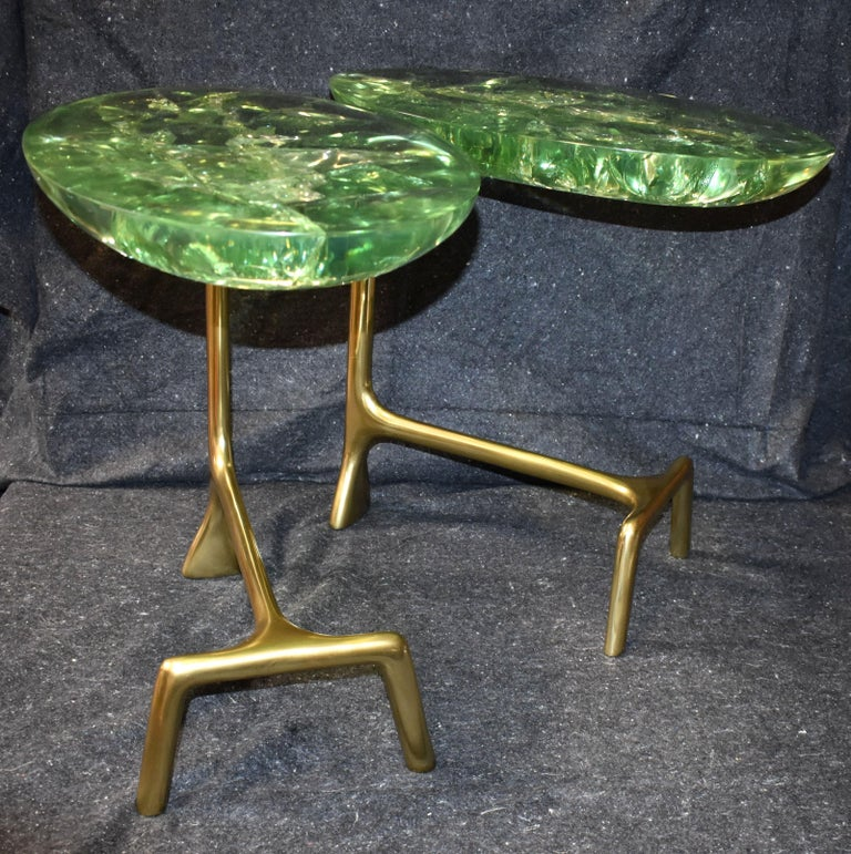 Pair of sculptural thick green ice cracked resin top on solid brass base end tables.