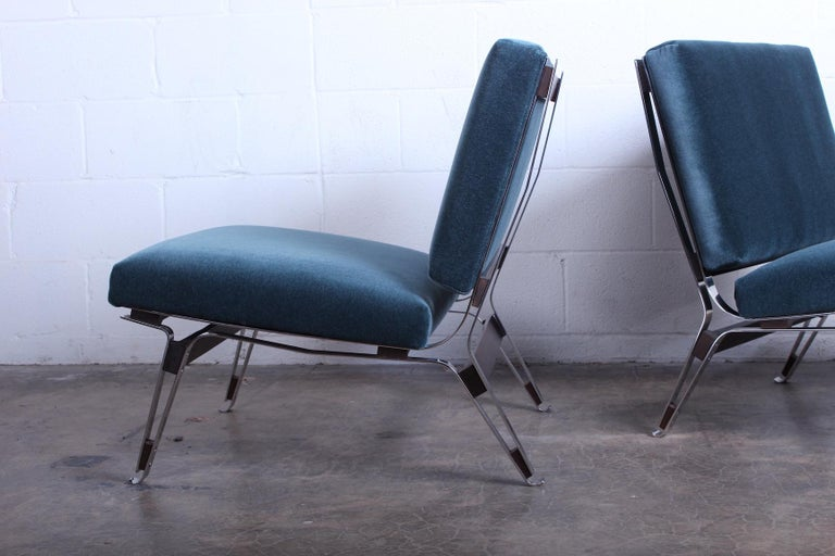A pair of model 856 lounge chairs designed by Ico Parisi for Cassina. Upholstered in mohair.