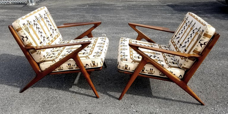 Iconic 'Z' lounge chairs designed by Poul Jensen for Selig, Denmark, circa 1950s. Most of these have been refinished. These retain the original printed linen upholstery and finish as well. A true time capsule and prime example.  Provenance: From