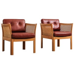 Pair of Illum Wikkelsø 'Plexus' Easy Chairs in Oak and Coqnac Leather, 1960s