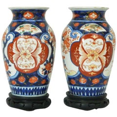 Pair of Imari Vases Depicting Floral Decorations on Stands, 19th Century