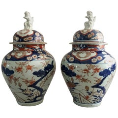 Pair of Imari Vases with Lids and Foo Dog Finials