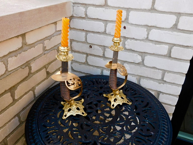 Pair of Antique Candle Holders made from 1889 model Prussian infantry officer's swords. They would of been made from unused swords, the manufacturer would create these candlesticks to give as gifts to stores as incentives to get favor to carry their