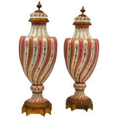 Pair of Important Covered Vases in Gilt Bronze and Sèvres Porcelain