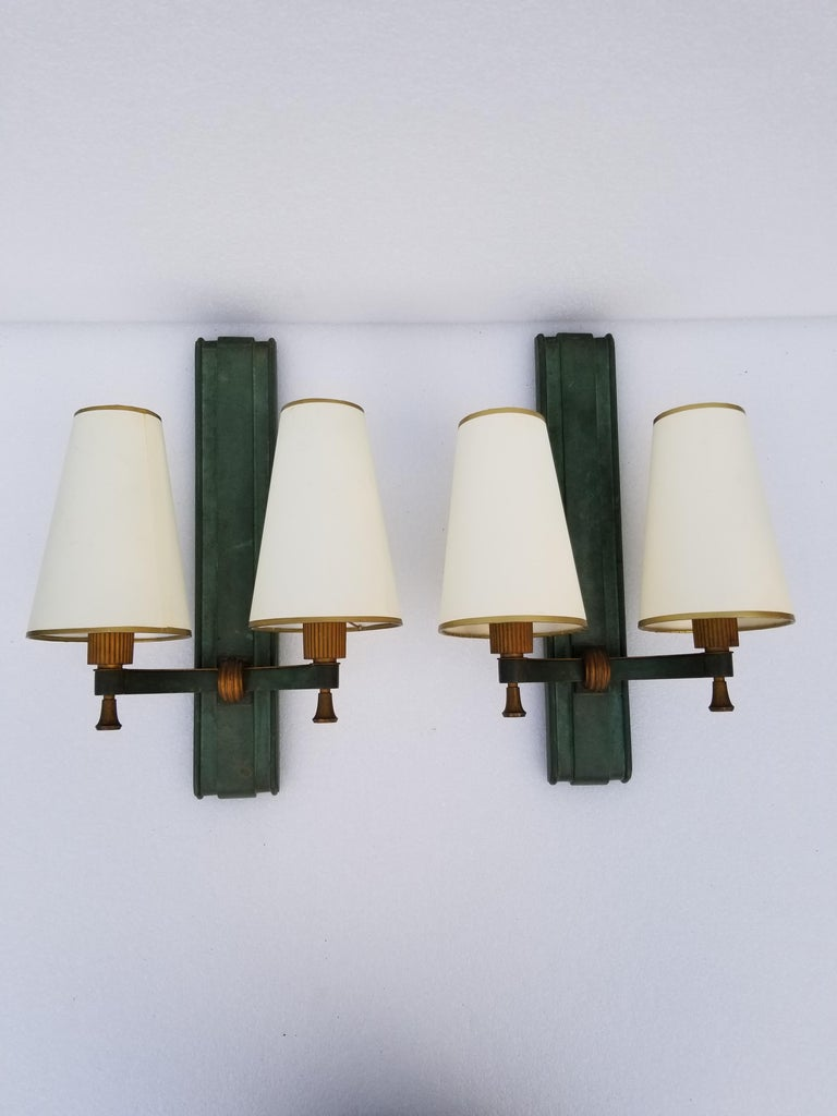 Pair of important Genet & Michon bronze sconces, original green patina, superb quality from 1940, heavy bronze . 2-light, 40 watts max bulb. New parchment shades.