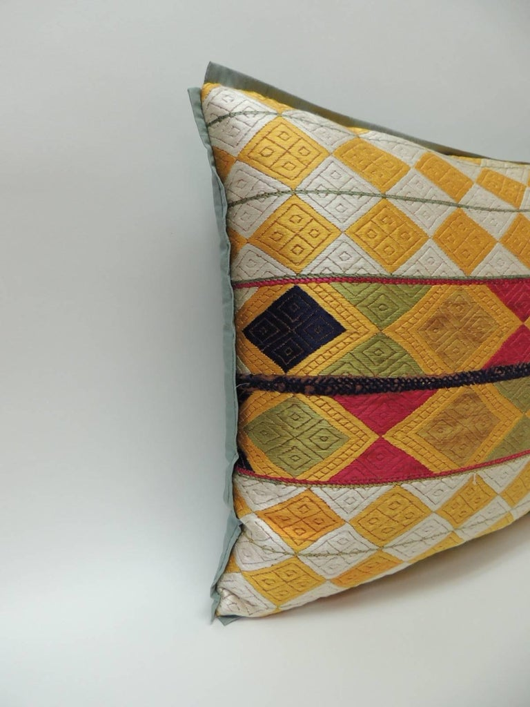"""Pair of Indian 19th century """"Phulkari"""" Artisanal decorative bolster pillow The front pattern is made of silk embroidered diamonds with a colorful band of larger diamonds in the center creating a striped design of larger diamonds across the front"""