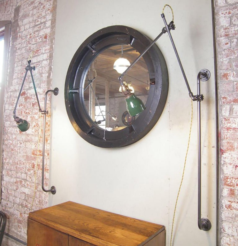 Pair of vintage Industrial adjustable wall sconces, lights. Made from steel poles, cast iron fittings and new cloth wire. Antique shades will vary slightly. All parts are from the US and we produce the light in our Connecticut workshop. Arms measure