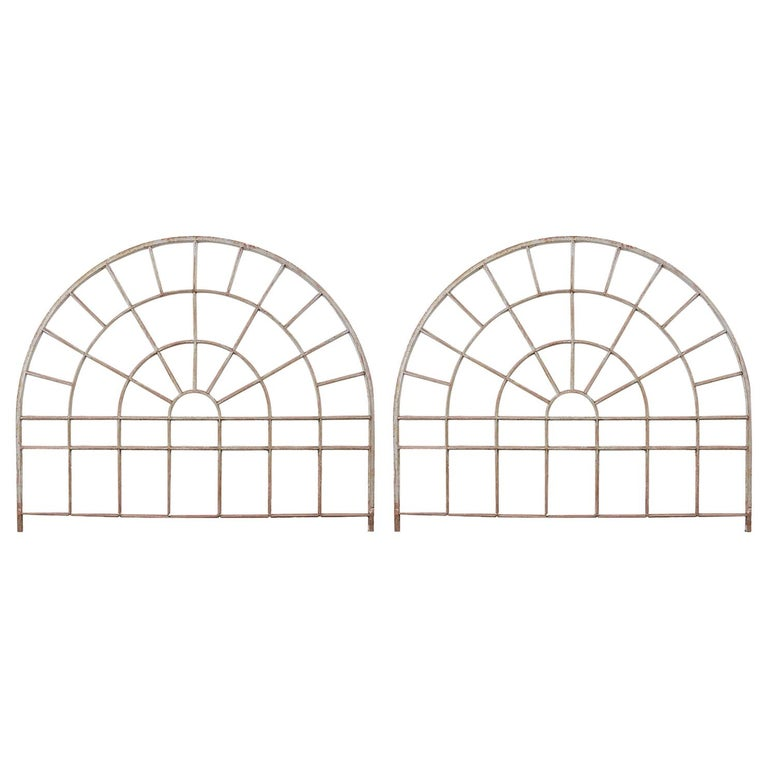 Pair of Industrial Iron Arched Factory Transom Windows For Sale