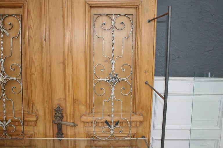A pair of iron door grills or grates. Also very decorative as an object hanging on the wall.  Dimensions: 87 cm high / 34.25 inch high, 26.5 cm wide / 10.43 inch wide, 1.5 cm deep / 0.59 inch deep.