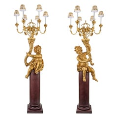 Pair of Italian 17th Century Six-Arm Cherub Candelabra Torchières, circa 1680