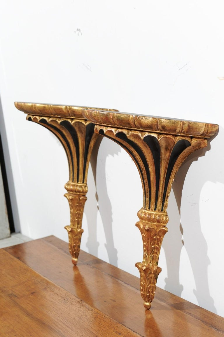 Wood Pair of Italian 1870s Carved Wall Brackets with Gold and Black Painted Accents For Sale