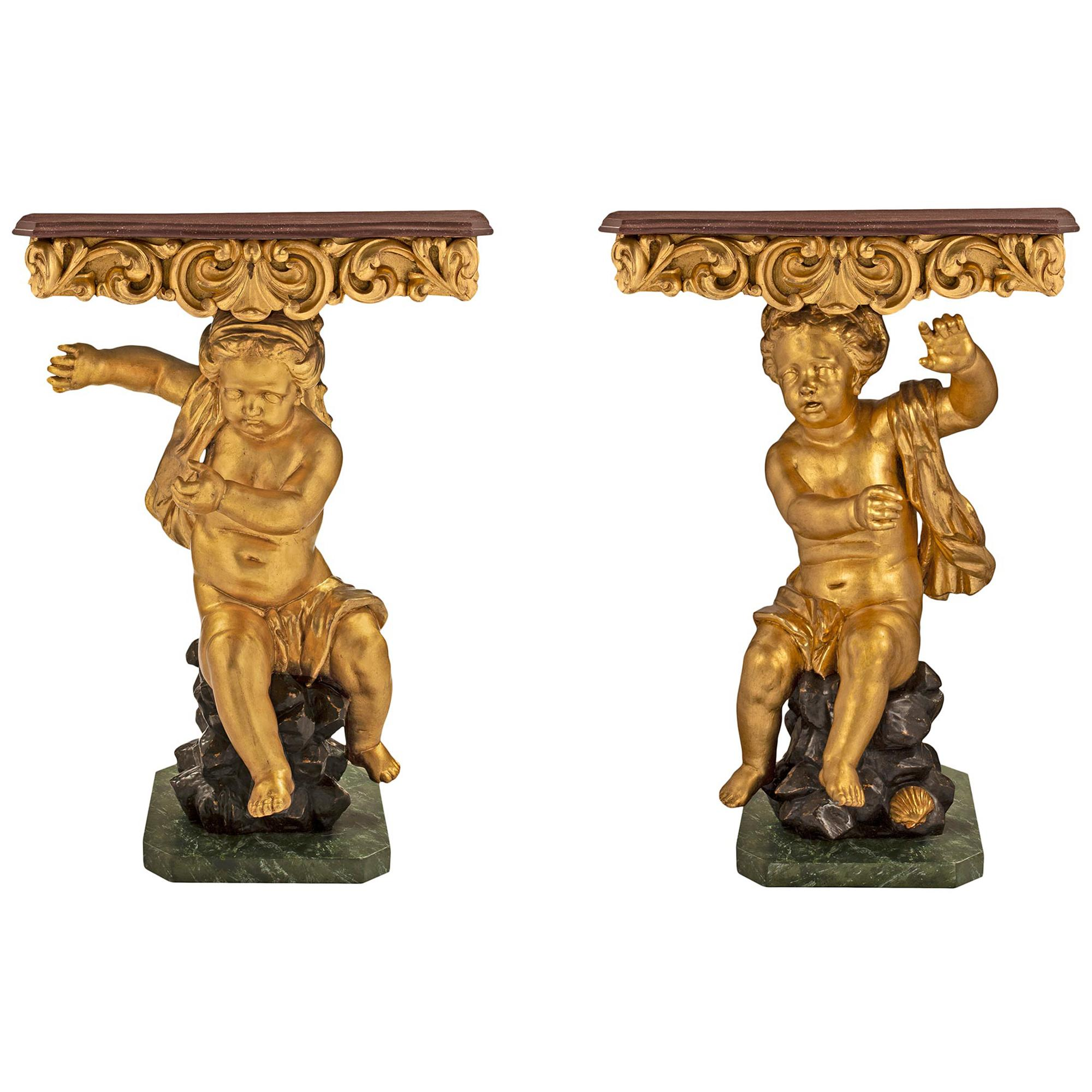 Pair of Italian 18th Century Baroque Giltwood and Faux Painted Consoles