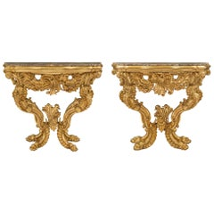 Pair of Italian 18th Century Baroque Giltwood and Marble Four Legged Consoles