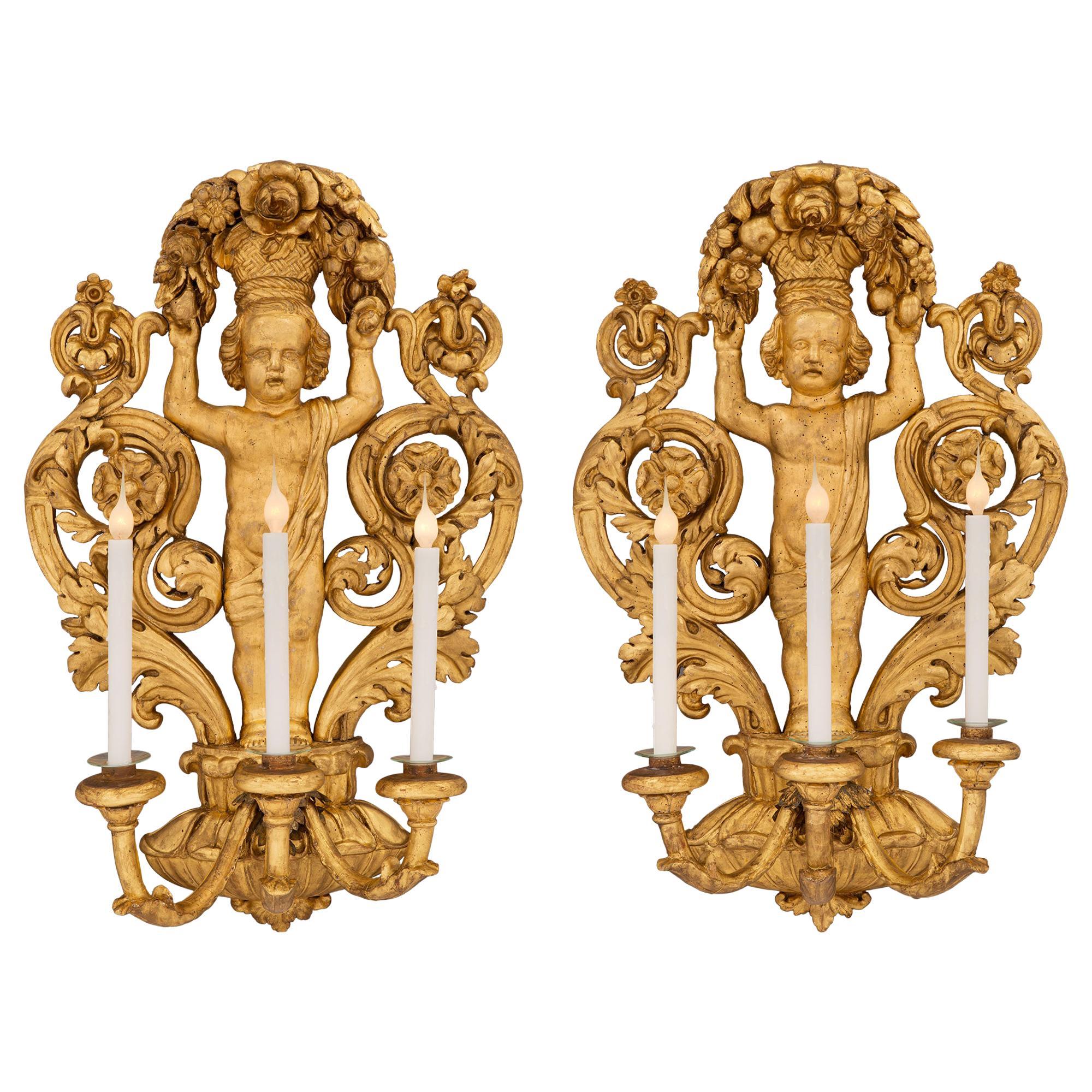 Pair of Italian 18th Century Baroque Period Giltwood Three-Arm Sconces