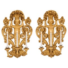 Pair of Italian 18th Century Baroque Period Giltwood Three-Arm Sconces