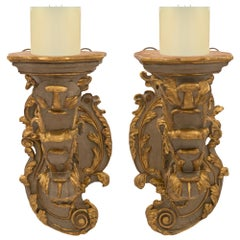 Pair of Italian 18th Century Baroque Period Patinated and Giltwood Sconces
