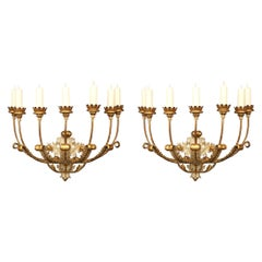 Pair of Italian 18th Century Giltwood and Patinated Seven Arm Sconces