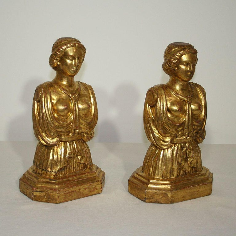Unique couple of giltwood busts.