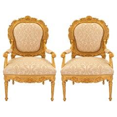 Pair of Italian 18th Century Louis XV/XVI Giltwood Throne Armchairs