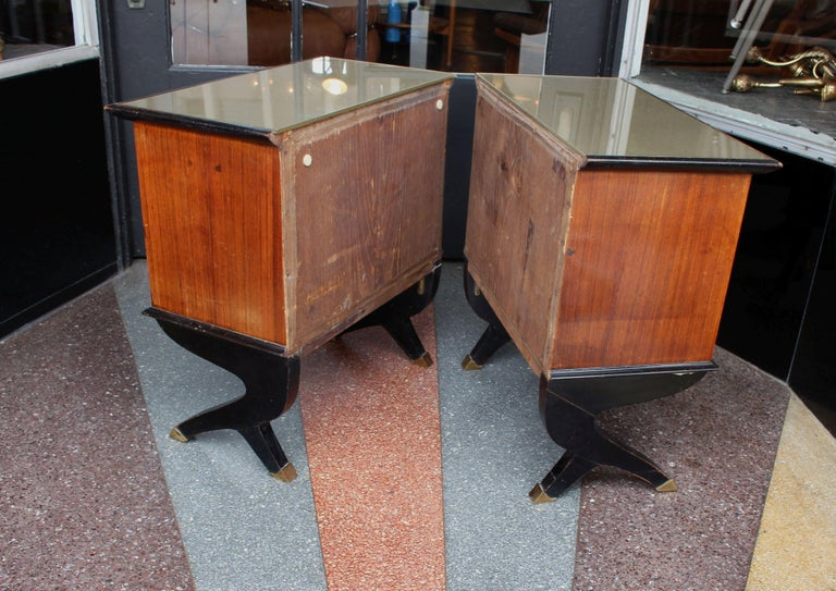 Italian pair of side tables, rosewood and the top is glass mirror. Bottom of the legs are the brass bouts. Side tables are in original condition as shown on the photos.