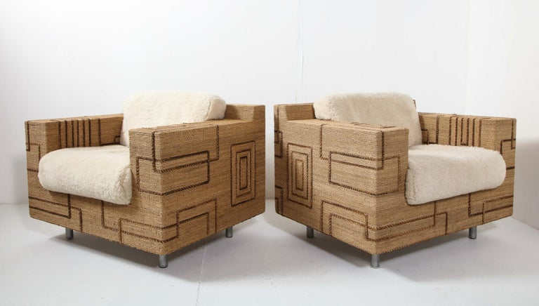A pair of 1970s Italian rope-inlaid lounge chairs, with geometric line patterns in a contrasting color. Cylindrical metal legs. Newly made shearling cushions, separate back & seat cushions.   Measures: Arm height: 24