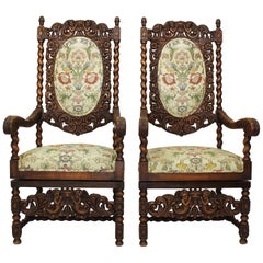 Pair of Italian 19th-20th Century Baroque Style Walnut Carved Throne Armchairs