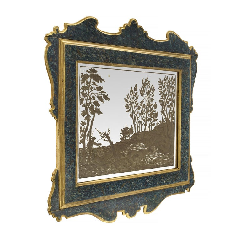 A charming and most decorative true pair of Italian 19th century etched mirror and faux painted blue tortoiseshell polychrome mirrors. The beautiful original frames display a wonderfully executed faux painted polychrome tortoiseshell design with