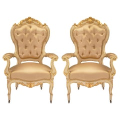 Pair of Italian 19th Century Louis XV Style Patinated and Giltwood Armchairs