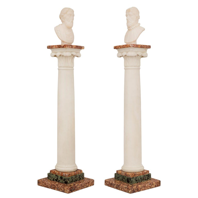 An exceptional pair of Italian 19th century neoclassical St. Grand Tour marble columns. Each handsome column is raised by a square Brocatelle d'Espagne base with a fine stepped design and Vert antique marble. The circular central white Carrara