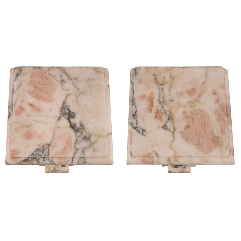 A beautiful pair of Italian 19th century neoclassical style onyx, white Carrara, Cipollino, and Occhio di Pavone Rosso marble pedestal columns. Each pedestal is raised by a most decorative base with cut corners and a beautiful mottled design. The
