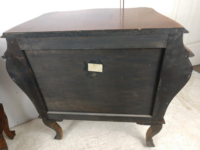 Elegant 3 drawer Rococo style bombe chests perfect for bedside or a living room. Created from walnut and in excellent vintage condition with minimal wear. Beautiful curves with original hardware and finish.