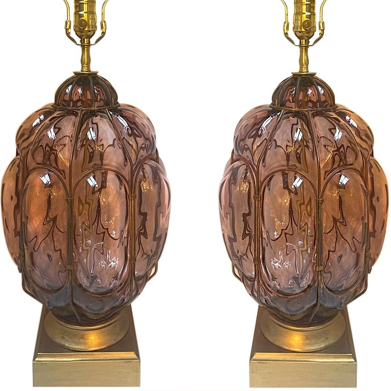 A pair of circa 1940's blown Murano glass table lamps with gilt bases.  Measurements: Height of body: 18.5